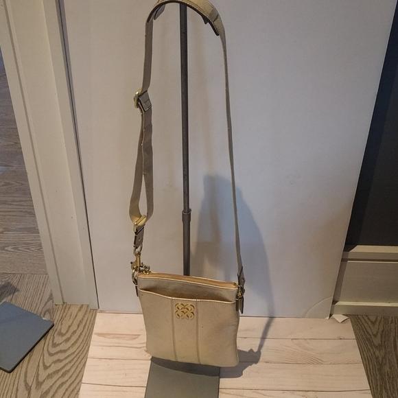 🍀🌺 Gold  croosbody bag by Coach 🍀🌺
